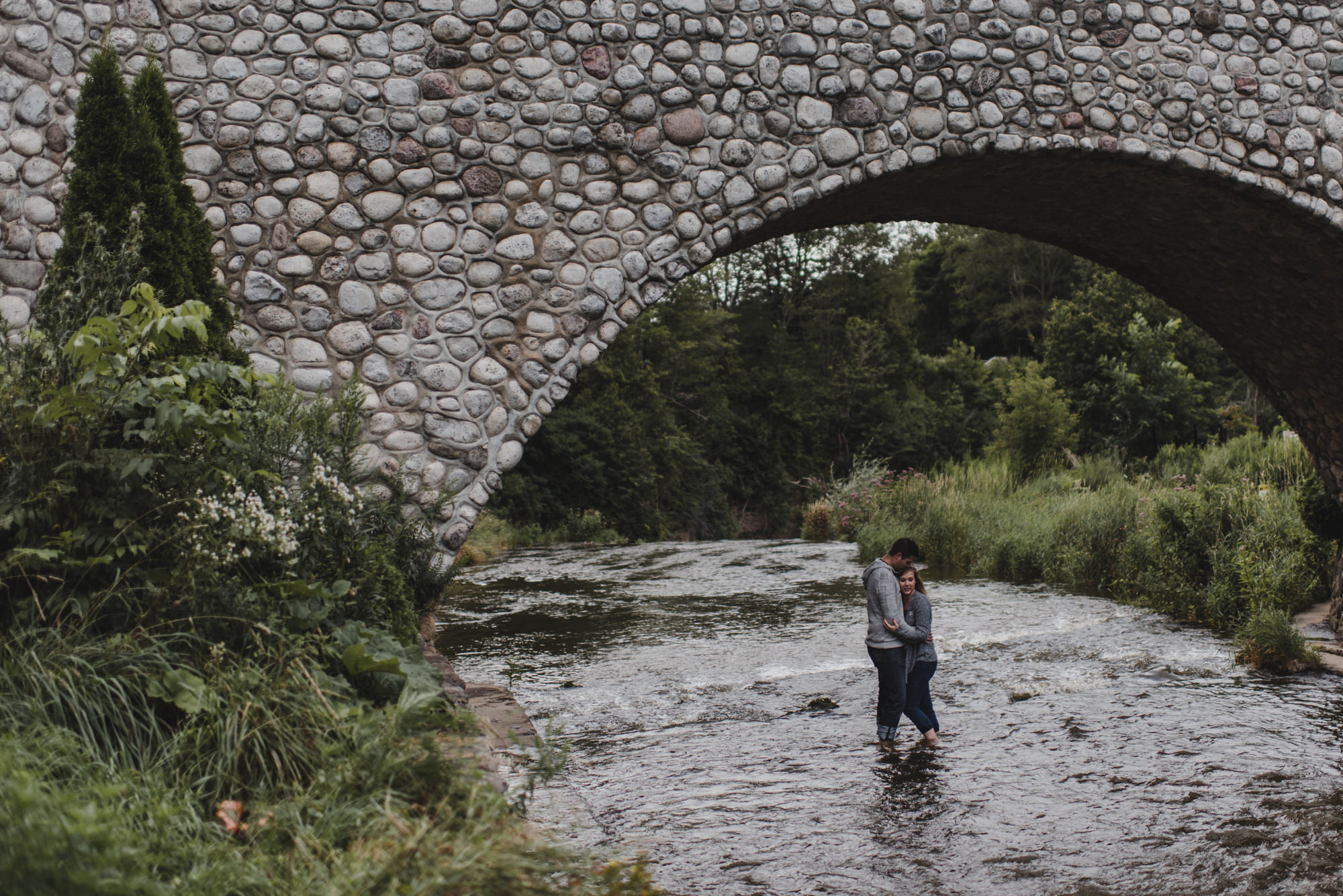 webster falls engagement photo, couple hugging, hamilton engagement